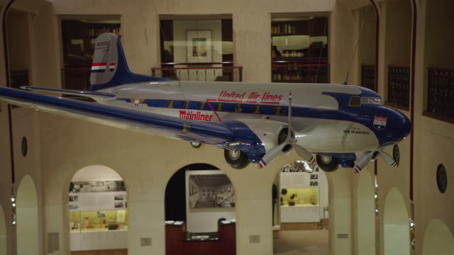 ms pan scale model airplane united air lines dc-3 hanging from ceiling in sfo museum - museum stock videos & royalty-free footage
