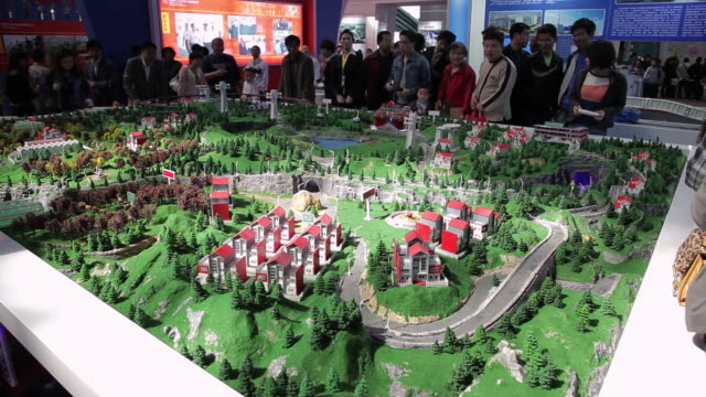 ms scale model of living estate projects in exhibition center / xi'an, shaanxi, china - 展覧会点の映像素材/bロール