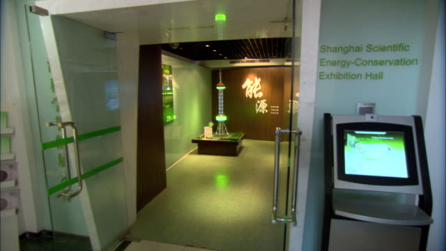 montage scaled model of oriental pearl television tower in shanghai scientific energy conservation exhibition hall at shanghai energy resource center, shanghai, china - glowing doorway stock videos & royalty-free footage