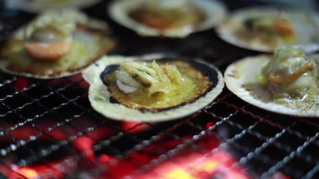 Scallop grilled on bbq stove .