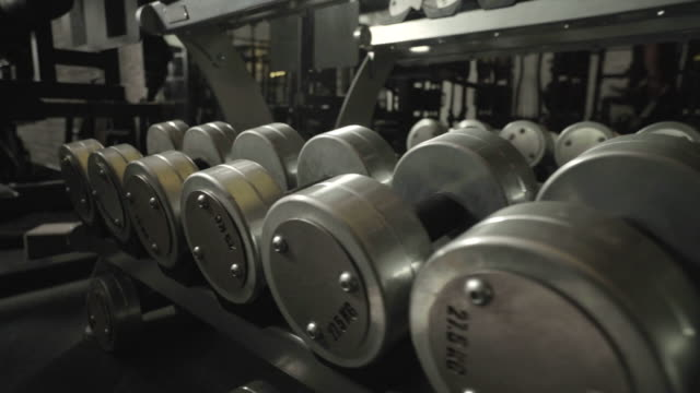 scan of dumbbell rack equipment - exercise equipment stock videos and b-roll footage