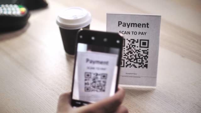 scan to pay, qr code cashless payment contactless payment through smart phone to buy take away coffee at counter bar in coffee shop cafe, slow motion - checkout stock videos & royalty-free footage