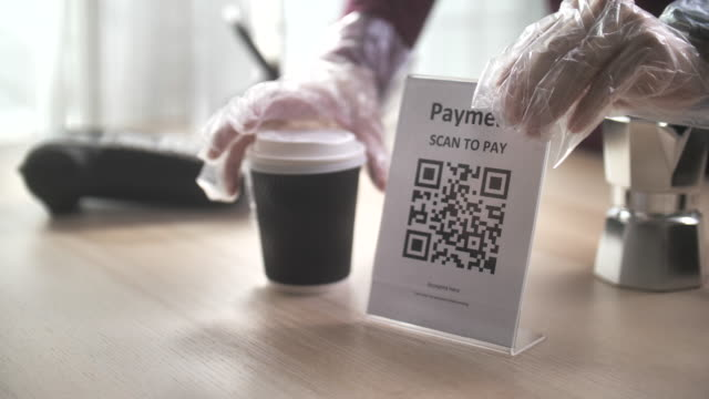 scan to pay, qr code cashless payment contactless payment through smart phone to buy take away coffee at counter bar in coffee shop cafe, slow motion - paying restaurant stock videos & royalty-free footage