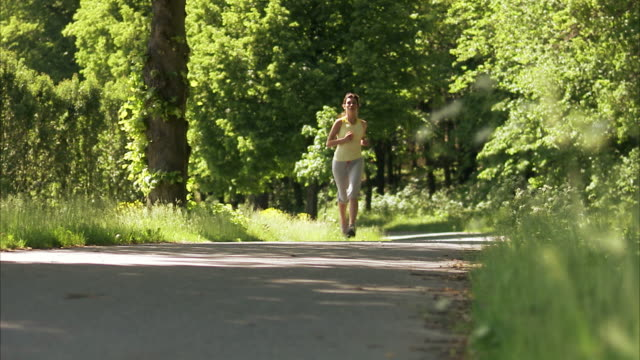 scandinavian woman jogging sweden. - weg stock-videos und b-roll-filmmaterial