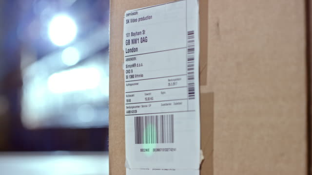 scanning a code on a shipping label - label stock videos & royalty-free footage