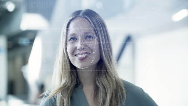 scanning female identity in office with facial recognition technology - hologram bildbanksvideor och videomaterial från bakom kulisserna