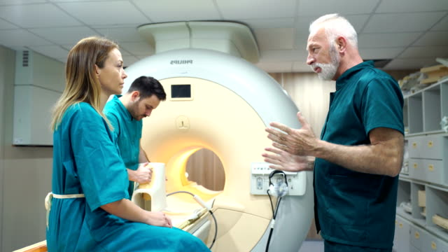 mri scanning procedure. - examination gown stock videos and b-roll footage
