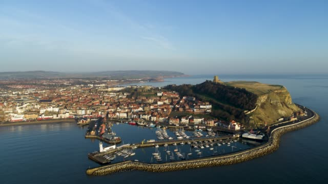 scarborough harbour & castle, south bay, scarborough - north sea stock videos & royalty-free footage