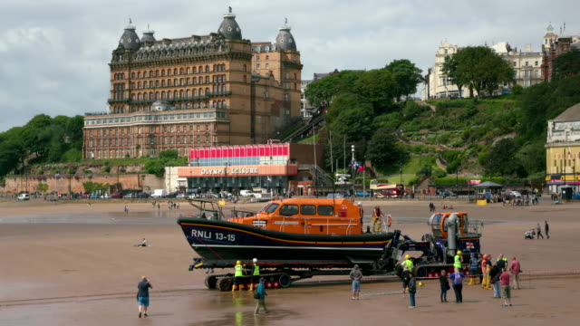 scarborough lifeboat launch training south beach  scarborough - scarborough uk stock videos & royalty-free footage