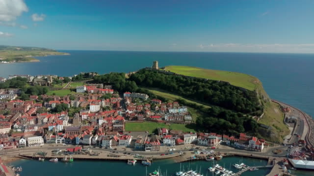 scarbourgh castle and harbour scarborough south bay  north yorkshire - scarborough uk stock videos & royalty-free footage