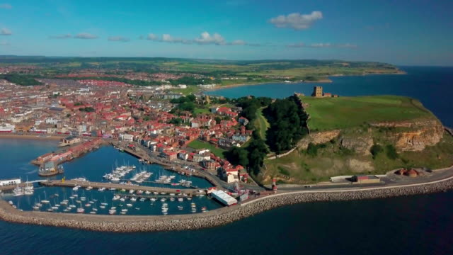 stockvideo's en b-roll-footage met scarbourgh castle & harbour scarborough south bay  north yorkshire - scarborough engeland