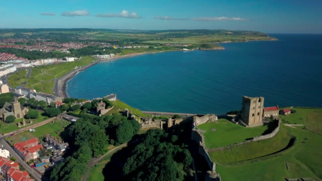 scarbourgh castle & north bay scarborough south bay  north yorkshire - 英国スカーブラ点の映像素材/bロール