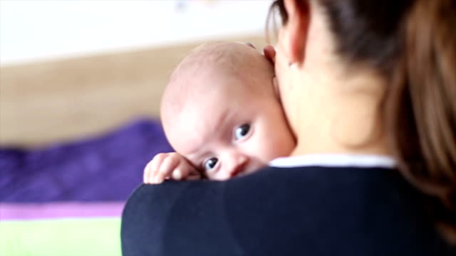 scared baby in mother's arms - postpartum depression stock videos & royalty-free footage