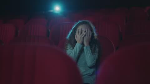 scared girl in cinema - film screening stock videos & royalty-free footage