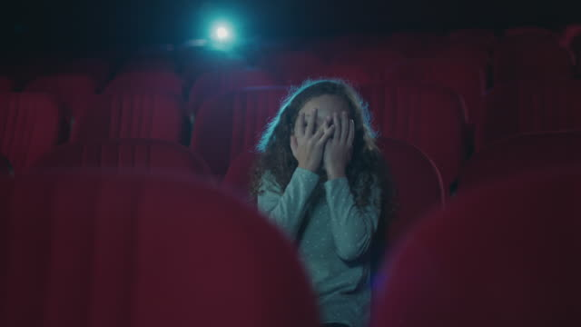 scared girl in cinema - film screening stock videos & royalty-free footage