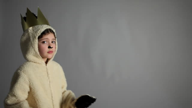 Scared looking young girl dressed as sheep