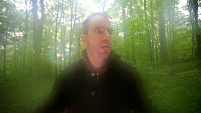 Scared man afraid in the forest