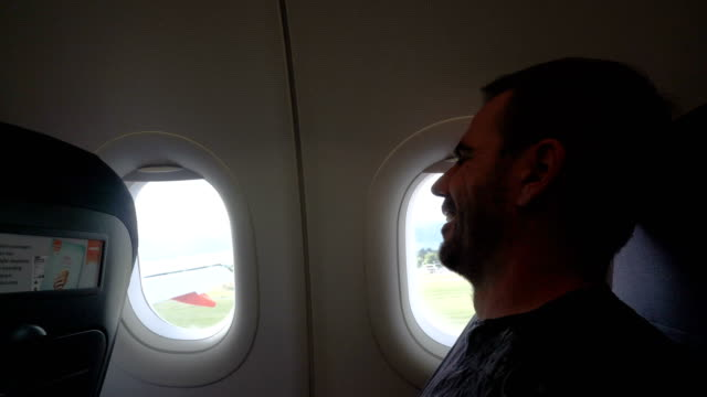 Scared man in the plane of rough landing