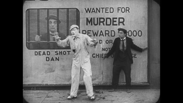 1921 scared man (buster keaton) runs away from man covered in cement who he thinks is a ghost - 1921 stock videos & royalty-free footage