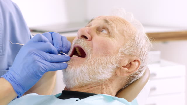 scared senior man at dentist office - dental health stock videos & royalty-free footage