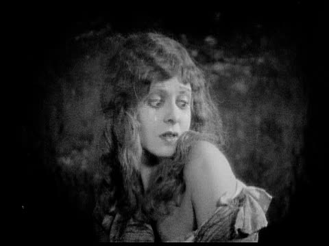 1926 b/w ms scared woman (charlotte stevens) cowering and looking over her shoulder / usa - acting stock videos & royalty-free footage