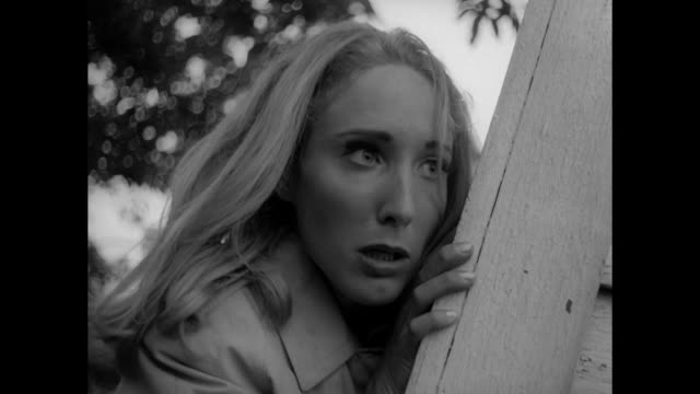 1968 scared woman flees from male zombie finding refuge in an empty house - hiding stock videos and b-roll footage