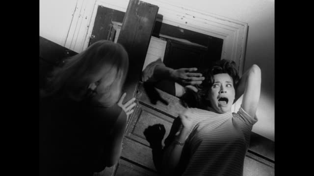 vídeos de stock e filmes b-roll de 1968 scared woman tries to defend another terrified woman against zombies - assustador