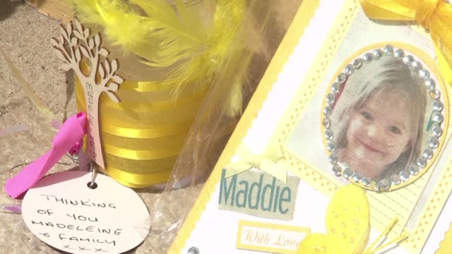 scarred by madeleine mccann's disappearance 10 years ago the seaside resort town of praia da luz in southern portugal is struggling to shake off the... - madeleine mccann video stock e b–roll
