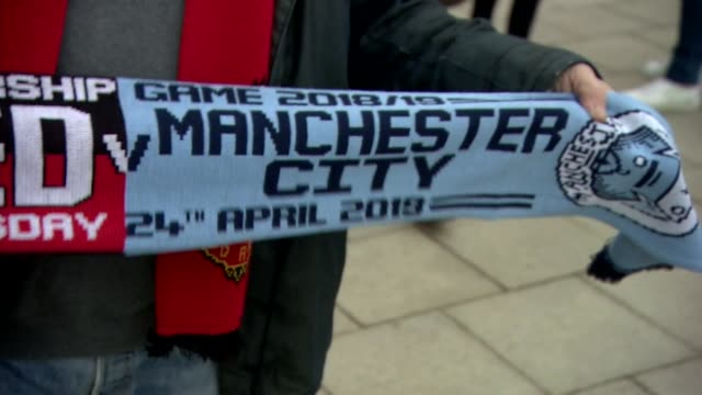 scarves and replica trophies on display outside old trafford before the manchester derby between manchester united and manchester city - football team stock videos & royalty-free footage