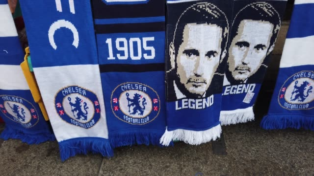 scarves with the chelsea badge on and the face of chelsea manager frank lampard prior outside the stadium prior to the premier league match between... - チェルシーfc点の映像素材/bロール