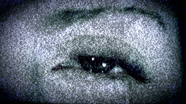 scary eye in tv static. hd - cable tv stock videos & royalty-free footage