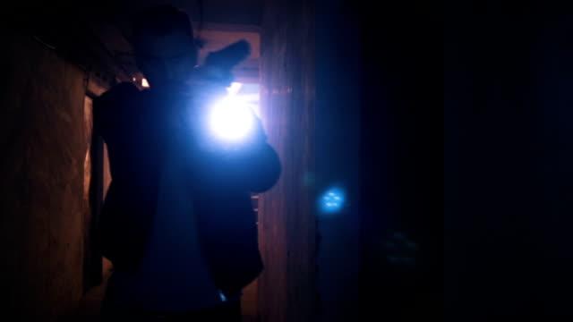 stockvideo's en b-roll-footage met scary ghost in de kelder - negatieve emotie