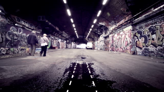 scary grunge graffiti-tunnel. hd - mauer stock-videos und b-roll-filmmaterial