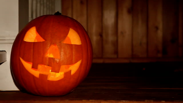 scary halloween jack o' lantern on loop - cut video transition stock videos & royalty-free footage