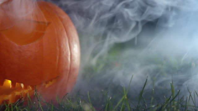 scary halloween pumpkin with smoke - jack o' lantern stock videos and b-roll footage