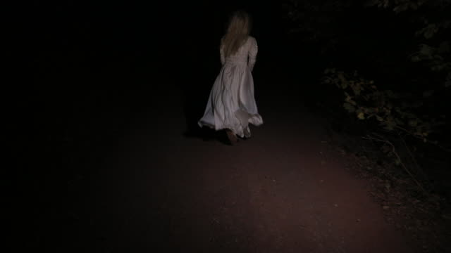 Scary witch in white