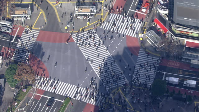 Scatter crossing in front of Shibuya Station; Tokyo; aerial shots
