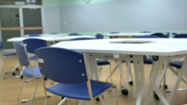 scene dolly shot of interior empty classroom in university, back to school - classroom stock videos & royalty-free footage