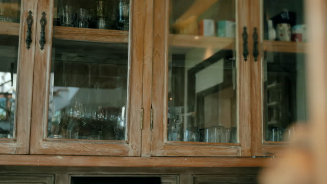 scene dolly shot of wine glass in cabinet vintage style and water glass etc at home, concept of day in the life objects - ancient stock videos & royalty-free footage