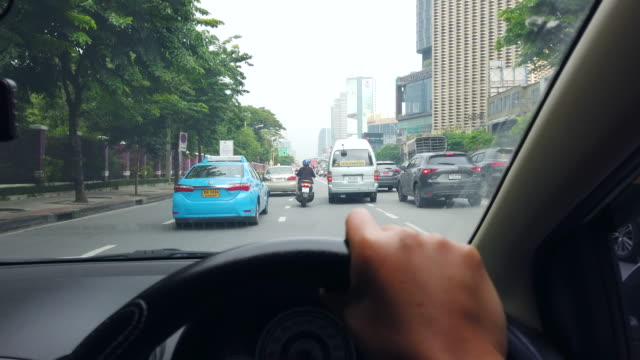 scene pov of driving on the road at bangkok in thailand, view from car front window - the way forward stock videos & royalty-free footage