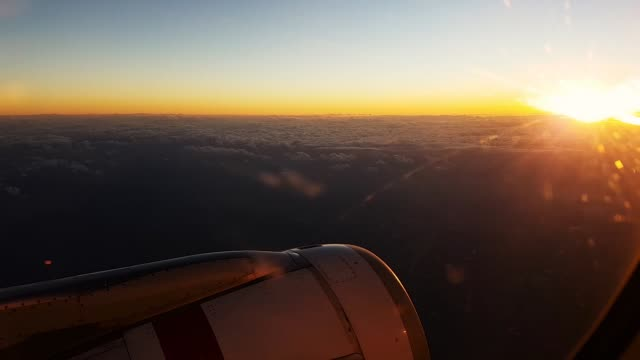 scene from aeroplane window in the slow sky motion clip sunset clouds smooth flying air calm - マイル点の映像素材/bロール