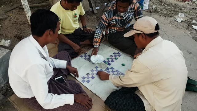 scene from bagan myanmar south east asia guys playing home made board game - carrom stock videos & royalty-free footage