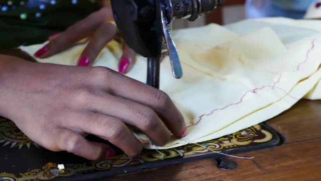 stockvideo's en b-roll-footage met scene from bagan myanmar south east asia slow zoom motion close up women using sewing machine in market - zoom out