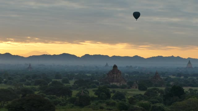 Scene from Bagan Myanmar South East Asia Sunset Temples and hot air balloons