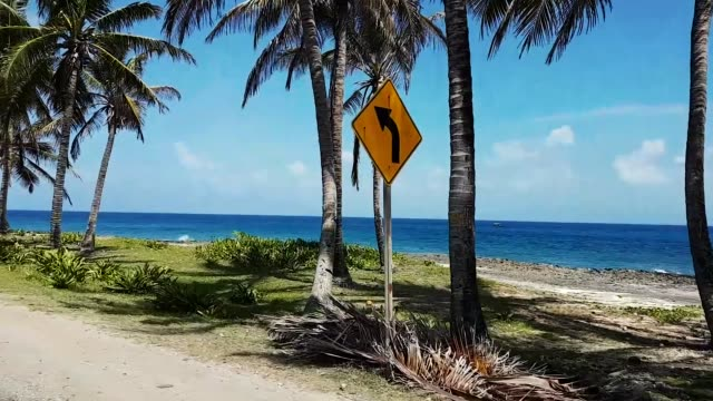 scene from colombia south america slow  motion of san andres golf cart driving round island - colombia stock videos & royalty-free footage