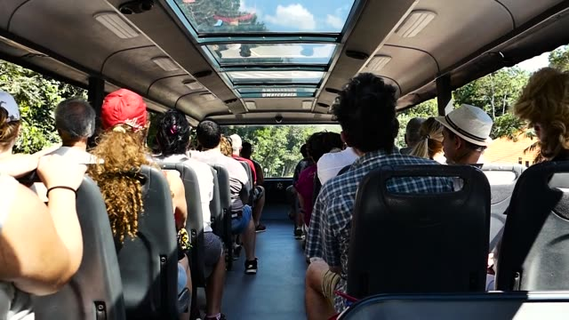 Scene from Countryside Brazil South America Slow still Motion shot zoom Group of Tourists Backpackers on bus
