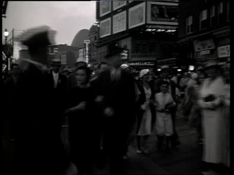 1933 DS Scene from film Convention City of large group of well dressed pedestrians walking down the street with marquees in background / Atlantic City, New Jersey, United States