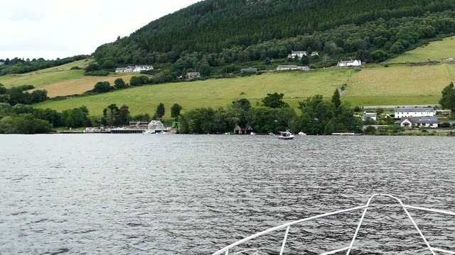 Scene from Lochness Scotland Slow Motion lake and castle