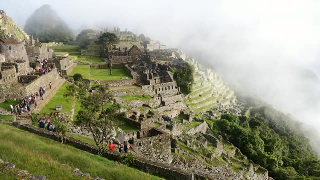 scene from mach picchu peru south america slow motion view of the buildings and landscape - tourist stock-videos und b-roll-filmmaterial