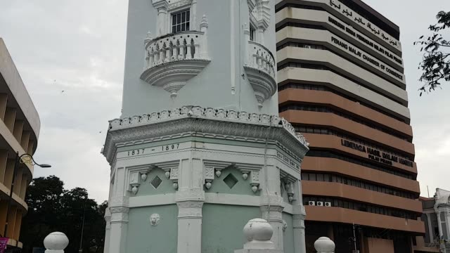 Scene from Penang Malaysia South East Slow Asia Motion PAN Queen Victoria Tower Clock Towering Landmark